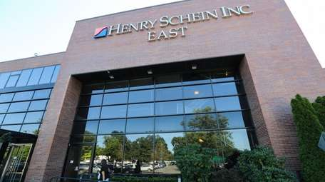 Health care products distributor Henry Schein Inc. topped