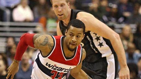 Trey Burke of the Washington Wizards dribbles up