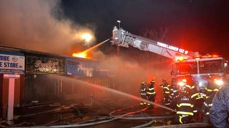A fire destroyed more than a dozen storefronts