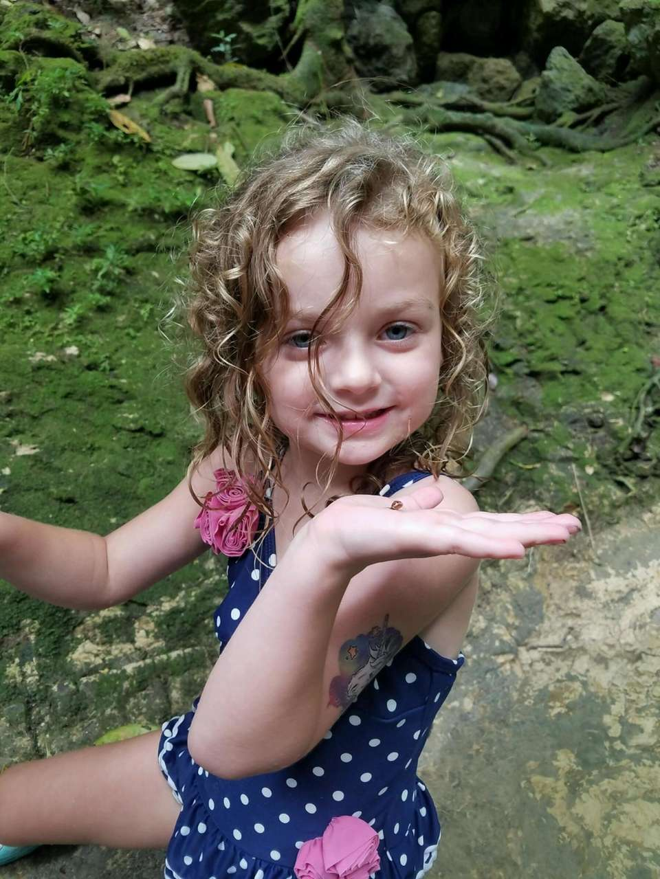 Madison playing with snails in rincon Puerto Rico