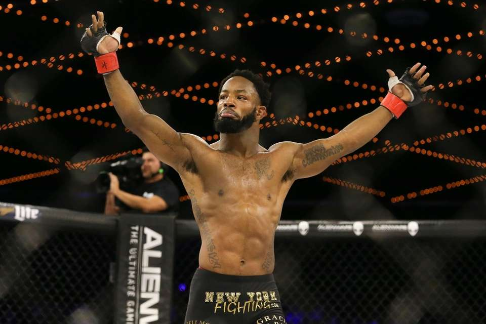Andre Harrison celebrates his 1st round submission win