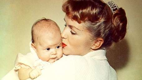 Debbie Reynolds holds baby Carrie Fisher in an