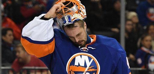 New York Islanders goalie Jaroslav Halak takes off