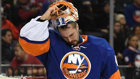 New York Islanders goalie Jaroslav Halak takes off