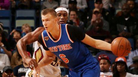 Kristaps Porzingis of the New York Knicks drives