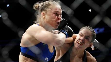 Amanda Nunes, right, connects with Ronda Rousey during