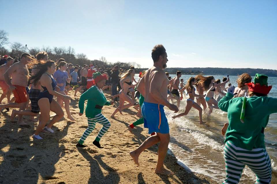People run into the water at Steers Beach