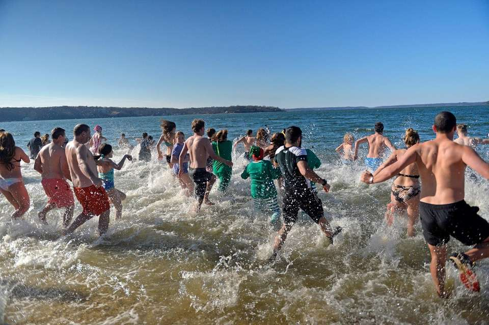 Participants head into the frigid waters during the