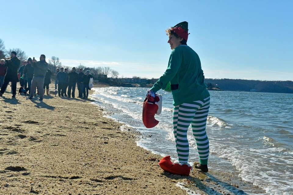 Huntington resident Sue Seltenreich-Cerillo, 54, tests the waters