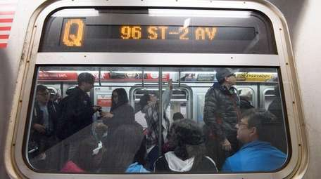 Passengers ride the first northbound Q train during