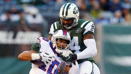 Darrelle Revis of the Jets tackles Robert Woods