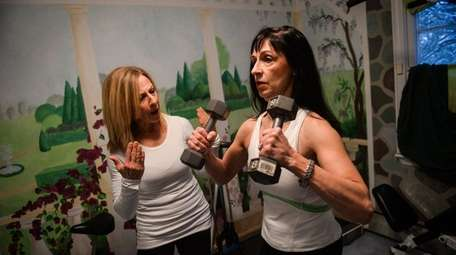 Susan Schlacter, right, works out with her personal