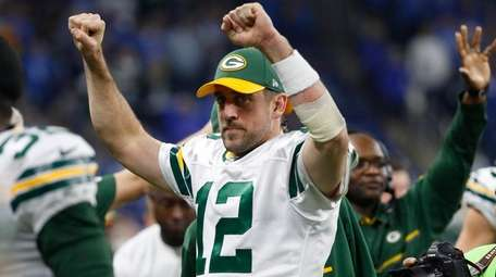 Green Bay Packers quarterback Aaron Rodgers reacts on