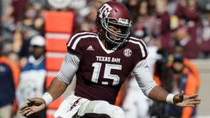 Texas A&M defensive lineman Myles Garrett reacts after