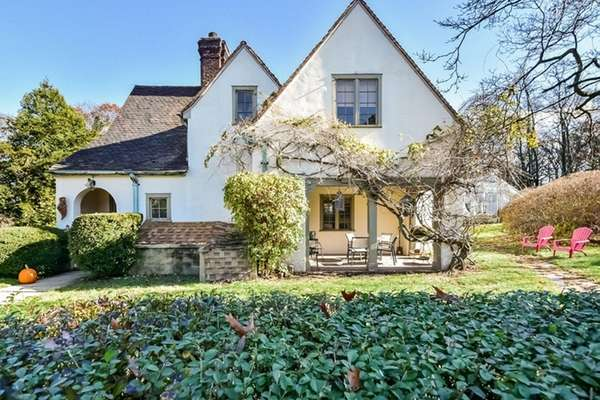 A carriage house and separate cottage that were