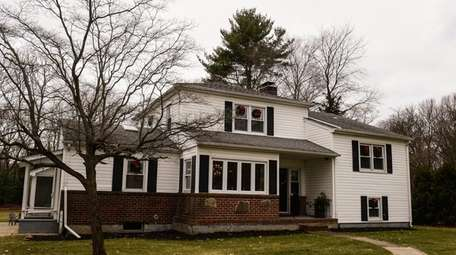 This four-bedroom split-level in Huntington is listed for