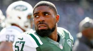 Victor Ochi of the New York Jets looks