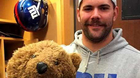 New York Giants' Justin Pugh and teddy bear