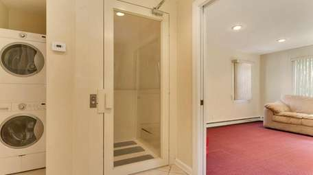 The elevator in this Dix Hills Colonial, on
