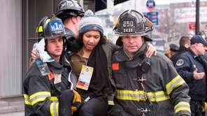 Emergency personnel tend to injured commuters after a