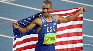 United States' Ashton Eaton celebrates winning the gold