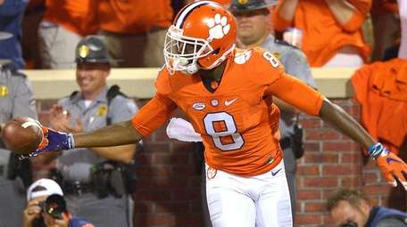 Deon Cain of the Clemson Tigers reacts after scoring