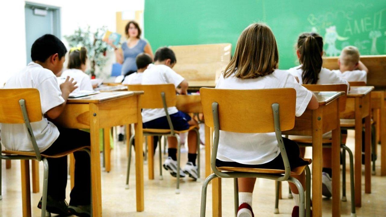 A teacher addressing a classroom.