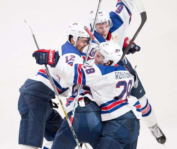 Team USA players celebrate after defeating Russia during