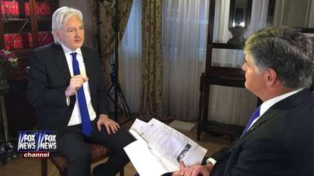 WikiLeaks founder Julian Assange, left, during an interview