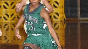 Brentwood's Ty Zhea Hawkins (13) brings the ball