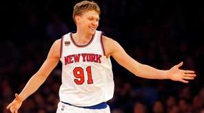 Mindaugas Kuzminskas of the New York Knicks smiles