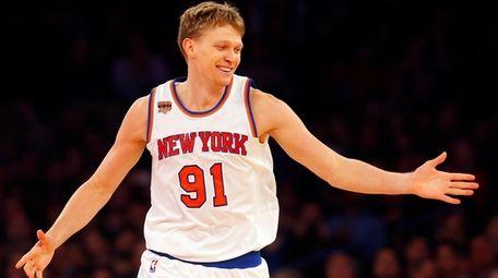 Mindaugas Kuzminskas of the New York Knicks smiles