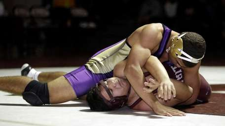 Central Islip's Malachi Lord Kelly pins Whitman's Luis