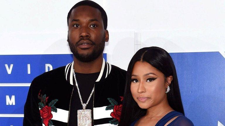 Nicki Minaj, right, confirms that she and rapper