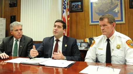 Suffolk County Police Commissioner Tim Sini, center, talks