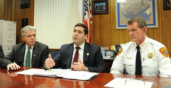 Suffolk County Police Commissioner Timothy Sini, center, talks
