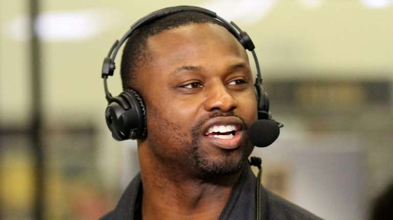 Former NFL player Bart Scott speaks during an