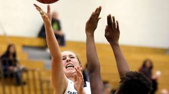 Smithtown West's Gabrianna Lorefice (3) drives for the