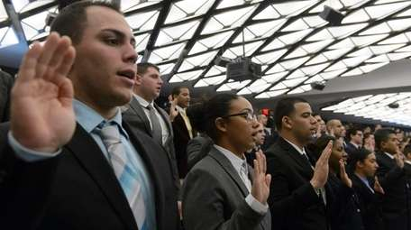 NYPD cadets are sworn in during a ceremony