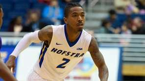Hofstra guard Deron Powers (2) dribbles past James