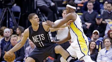 Nets center Brook Lopez holds off Pacers center