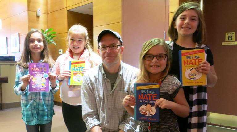 Author Lincoln Peirce with Kidsday reporters, from left,