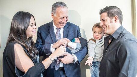 The Tepfer family -- Lisa, baby Dylan, Ryan,