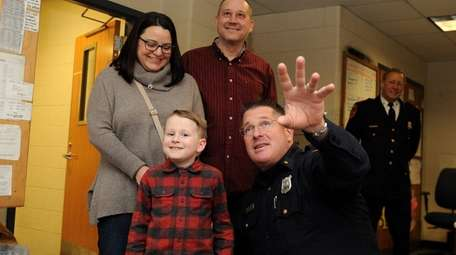 Officer Todd Bradshaw, right, gives Zachary Cote, 7,