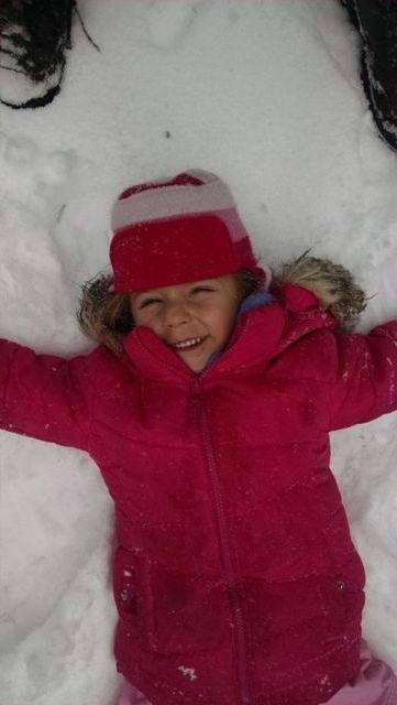 Emma Sophia Keneski making a snow angel!