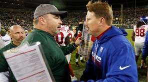 Packers coach Mike McCarthy (left) and Giants