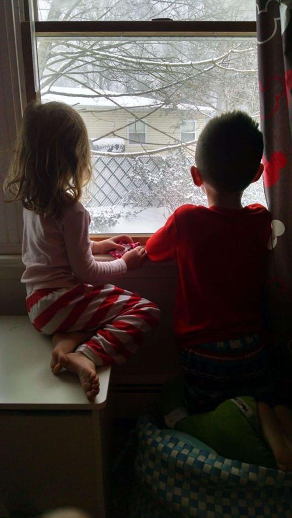 Ryan and Emma Keneski watching the snow while