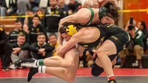 Commack's Nick Munsch, right, wrestles Locust Valley's Bailey