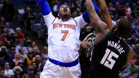 New York Knicks forward Carmelo Anthony, left, is