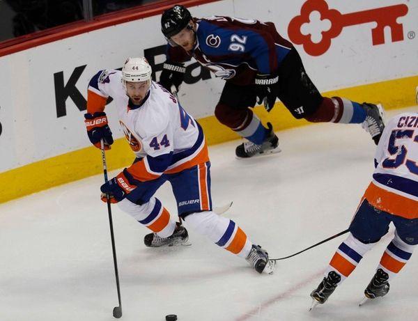 New York Islanders defenseman Calvin de Haan, front,